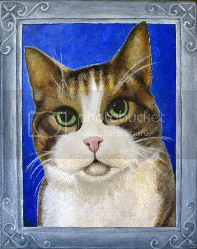 portrait of cat with green eyes in a silver frame